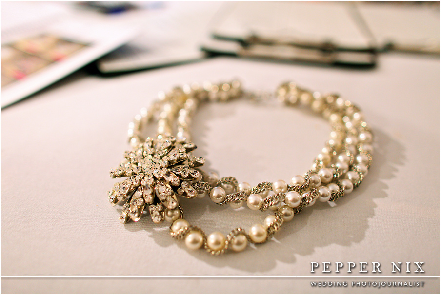 Chunky pearls with a large pendant is a modern and chic look