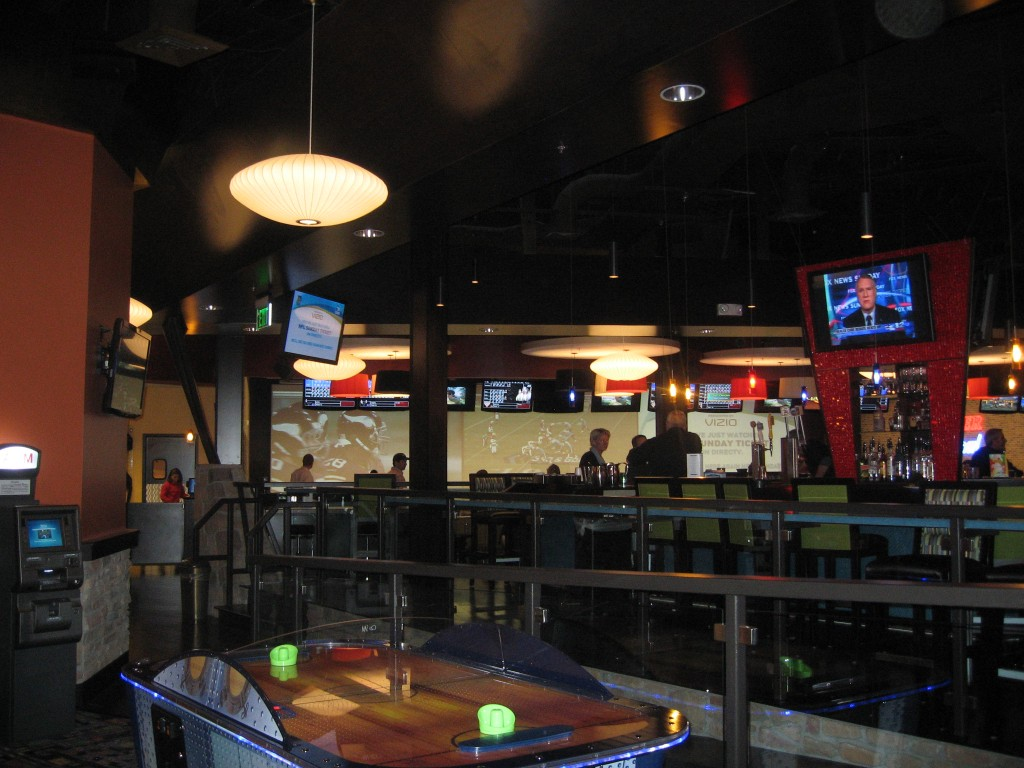 There is a game room stocked with video games, air hockey machines, photobooth, a putting machine, guitar hero and more!