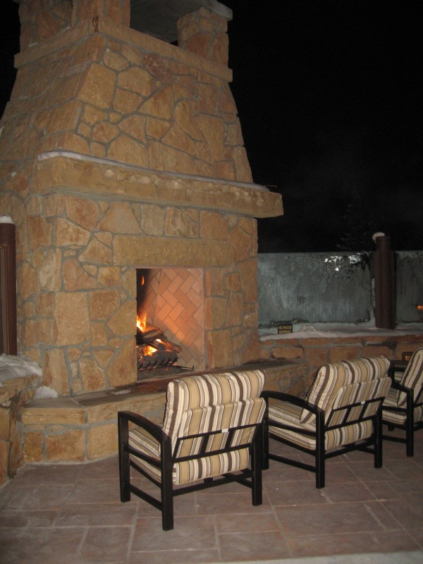 Cozy up to the outdoor fireplace