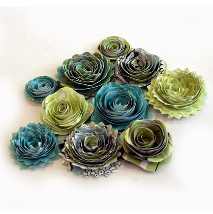 These beautiful paper spiral flowers in your wedding colors will allow you to make your DIY placecards by adding your guest name and table assignment.  Pin each flower to aspen logs creating your custom look.