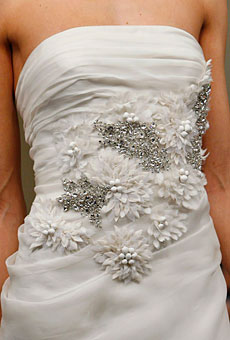 Reem Acra's Flowers and beading; A tradition you'll see today and in the 1800's.