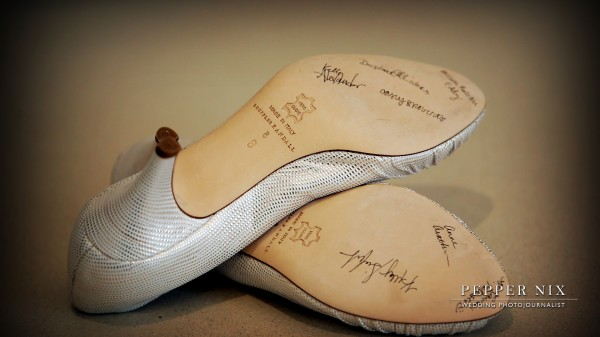 Each of the bridesmaids signed the bottom of the bride's shoes.  Tradition says, the name that stays on the shoe the longest will be the next girl to be married!