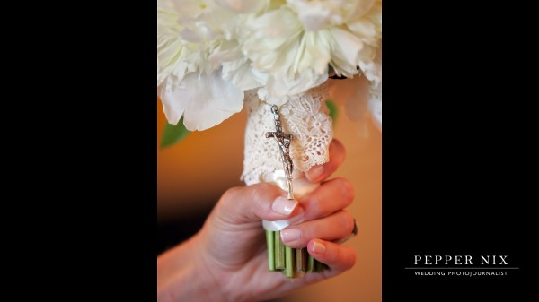 The bride had her grandmother's rosary wrapped around her bridal bouquet