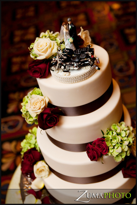 Chef Raymond created a 4 tier hazelnut chocolate cake and added a simple chocolate ribbon and coordinating floral
