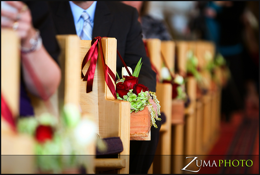Small teak boxes were hung from the pews full of beautiful burgandy and sage flowers.  After the ceremony the ribbons were removed and the boxes highlighted the mantle at Stein Eriksen Lodge