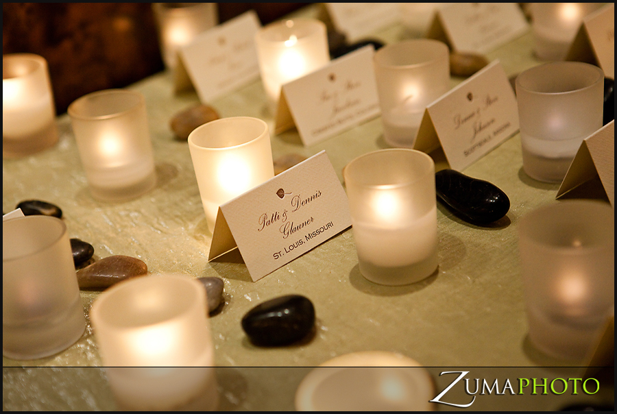 The placecard table was simple with natural river rock a leaf indicating leaves are starting to sprout and lots of candlelight